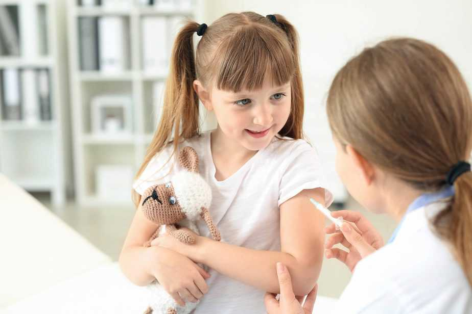 girl receiving a flu shot